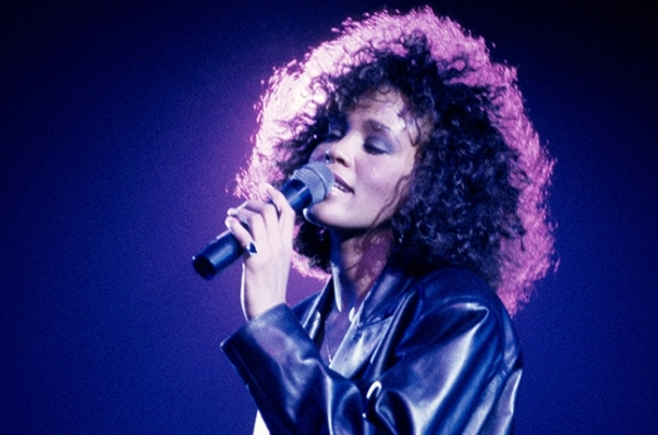 Whitney Houston performs at the Wembley Arena in London in 1988...